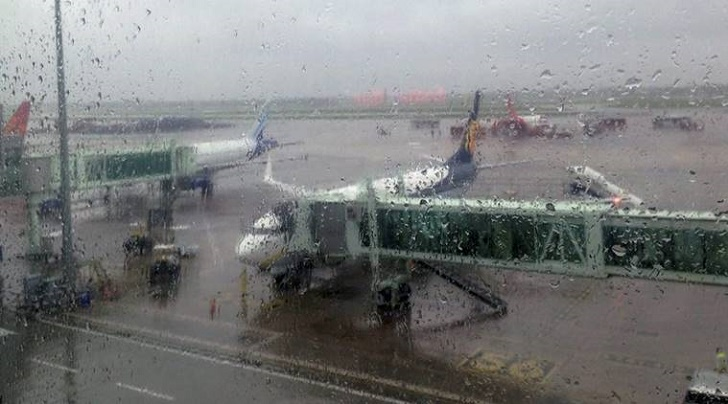 Kolkata: Aircrafts are seen on the tarmac amidst heavy rain in Kolkata on Monday. PTI Photo by Ashok Bhaumik(PTI10_9_2017_000062B)