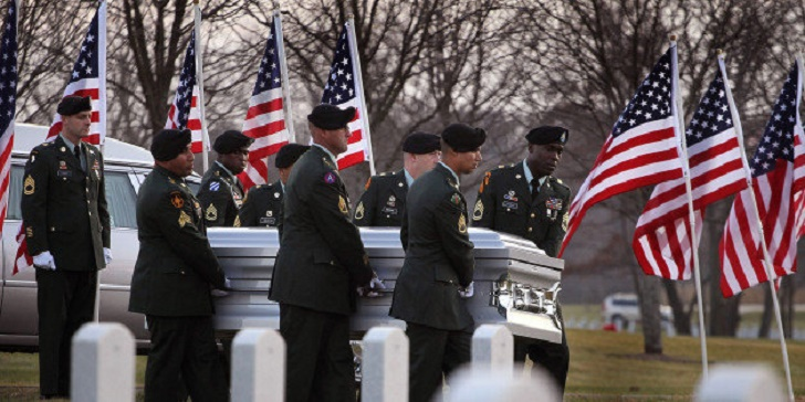 ELWOOD, IL - NOVEMBER 11:  Soldiers carry the remains of U.S. Army PFC Andrew Meari, of Plainfield, Illinois to their final resting place at Abraham Lincoln National Cemetery on November 11, 2010 in Elwood, Illinois. Meari, who was assigned to 1st Battalion, 502nd Infantry Regiment, 2nd BCT, of the 101st Airborne Division out of Fort Campbell, Kentucky, was killed November 1, in Kandahar, Afghanistan alongside fellow soldier SPC Jonathan Curtis when an insurgent attacked their unit with an improvised explosive device (IED).  (Photo by Scott Olson/Getty Images)