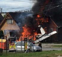 A house wrapped in flames is seen after a plane crashed and exploded in Puerto Montt
