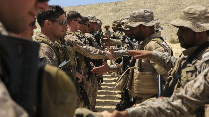 U.S. Marines with Charlie Company, 1st Battalion, 7th Marine Regiment, Special Purpose Marine Air-Ground Task Force-Crisis Response-Central Command, exchange gifts with Saudi Arabian Naval Special Forces at the end of a subject matter expert exchange while forward deployed in the Middle East, May 18, 2017. The exchange proved to be an enhancing opportunity for both the U.S. and Saudi forces. Deploying U.S. Marines into the U.S. Central Command area of responsibility to conduct combined military training with our partner nations' security forces strengthens our vital relationships with partners in this important region. (U.S. Marine Corps photo by Cpl. Kyle McNan)