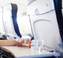 Man-in-the-aircraft-is-drinking-water