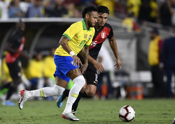 Sep 10, 2019; Los Angeles, CA, USA; Brazil forward Neymar (10) moves the ball while Peru midfielder Carlos Zambrano (15) defends during the the second half of the South American Showdown soccer match at Los Angeles Coliseum. Mandatory Credit: Kelvin Kuo-USA TODAY Sports