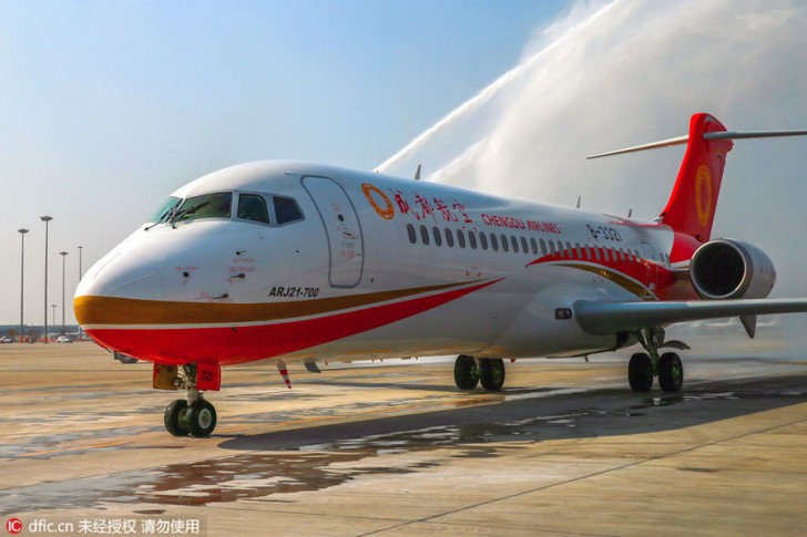 """""""A COMAC ARJ21 regional jet of Sichuan Airlines is washed after landing at the Chengdu Shuangliu International Airport in Chengdu city, southwest China's Sichuan province, 29 November 2015."""""""