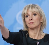 Russia's Foreign Ministry spokeswoman Zakharova reacts during the annual news conference in Moscow